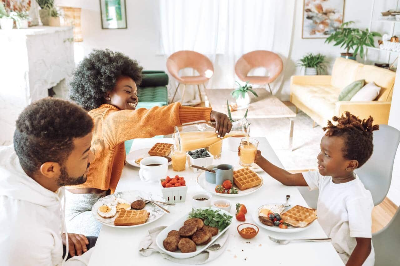 Family eating waffles at table