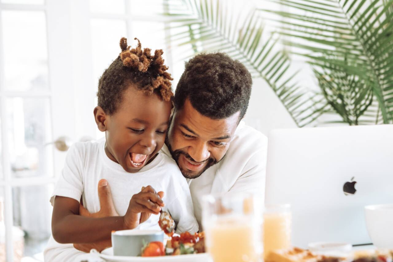 boy with dad eating breakfast