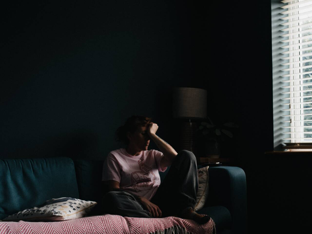 upset woman sitting on a couch