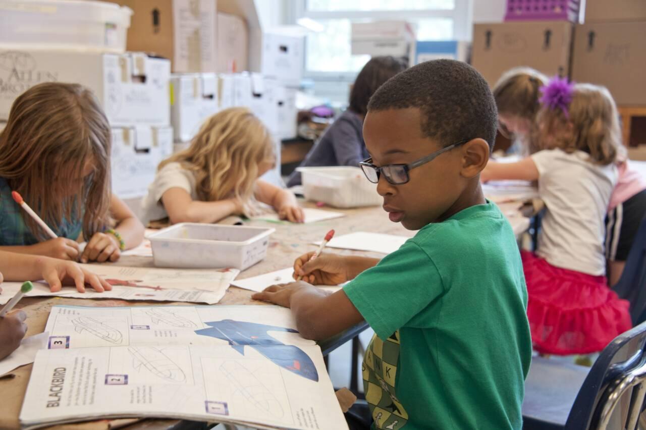 kids in classroom doing homework