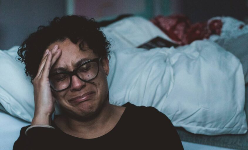 woman crying in her room
