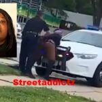 Woman keeps twerking even while getting arrested for pole dancing in the street.