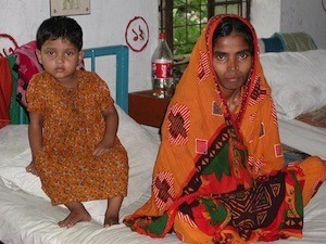 A mother and her child, both with TB, at the Jessore Segregation Hospital in Bangladesh © WHO/TBP/England