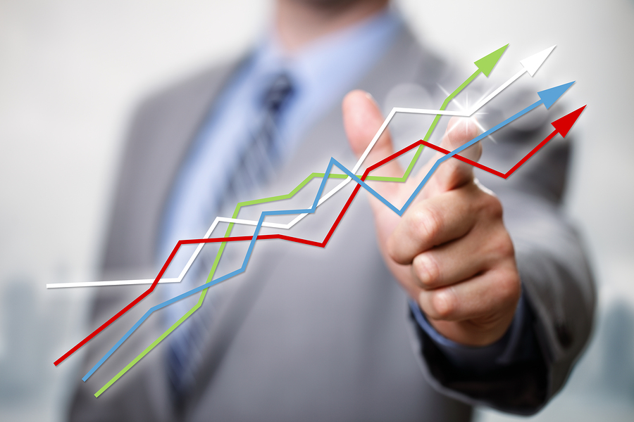 Businessman pointing to growth in a line graph showing business