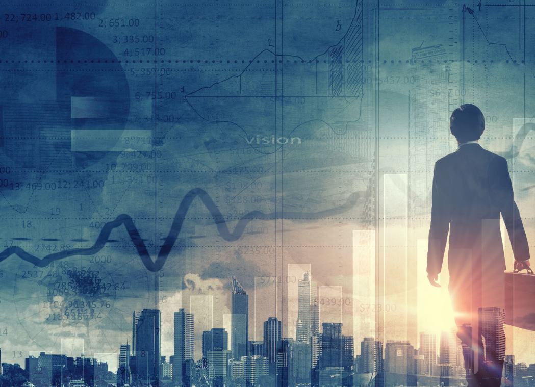 image of ceo with overlays of charts and city skyline