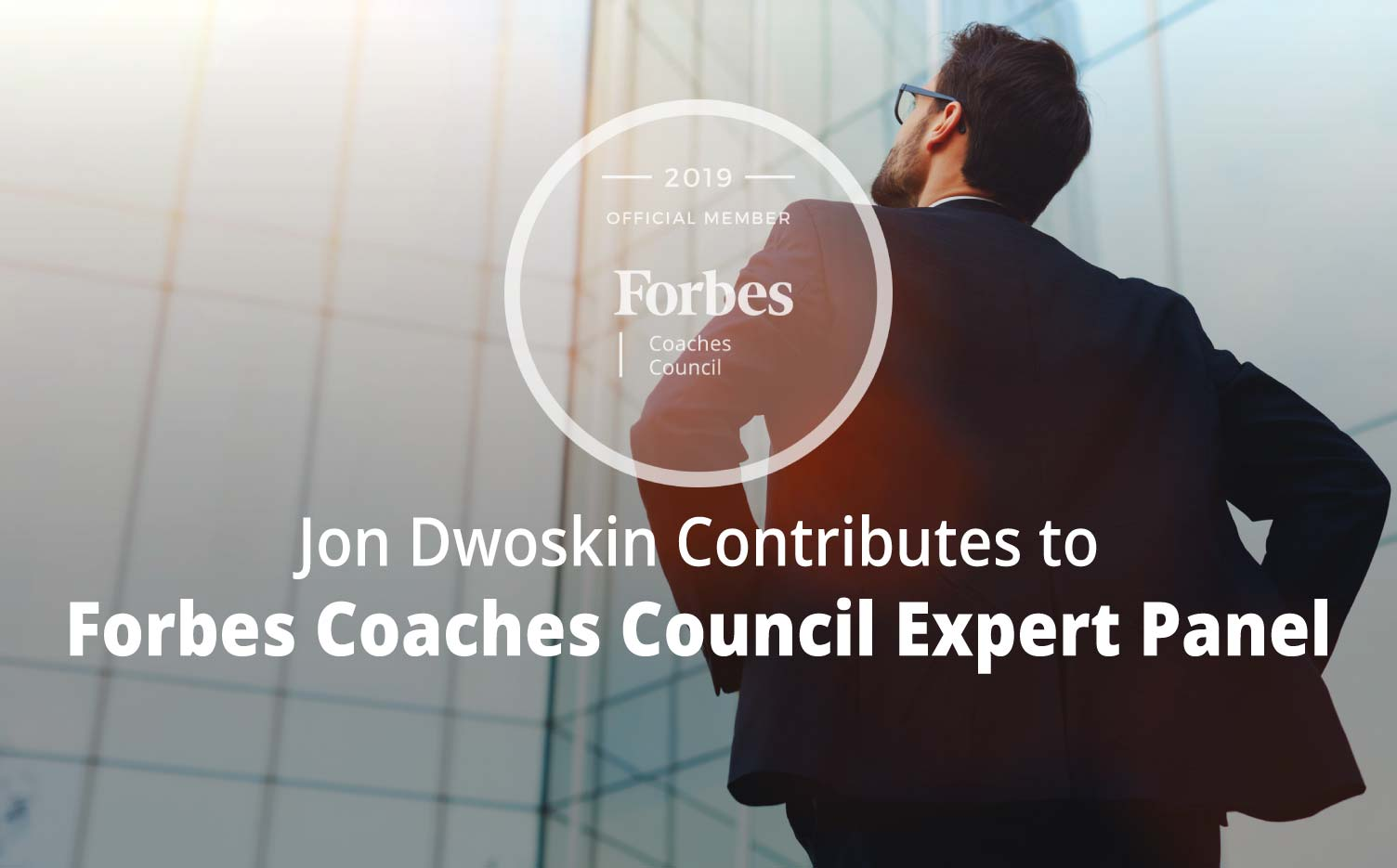 Forbes Coaches Council Expert Panel: Try These 11 Coach-Recommended Strategies To Break Your Negative Thought Patterns - Businessman looking up at building