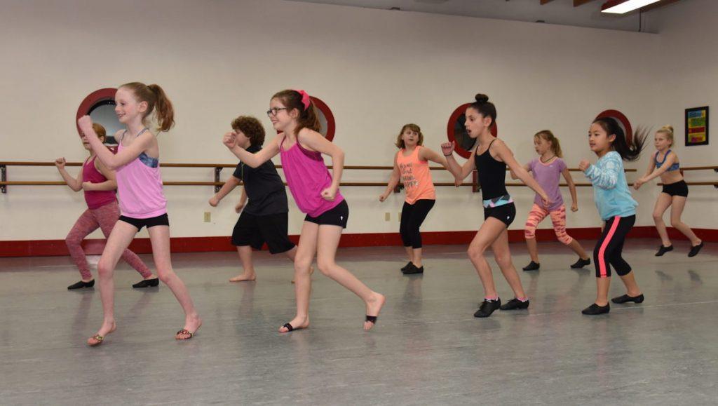 Pre-teen dancers take jazz class