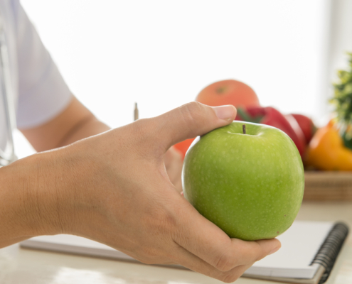 Dietitian holding an apple