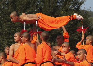 Shaolin monks perform qigong, a type of traditional Chinese martial arts, during the opening ceremony of the fourth Southern Shaolin Martial Arts Cultural Festival in Putian city