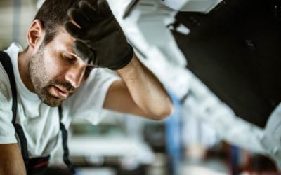 How does heat stress impact auto technicians?
