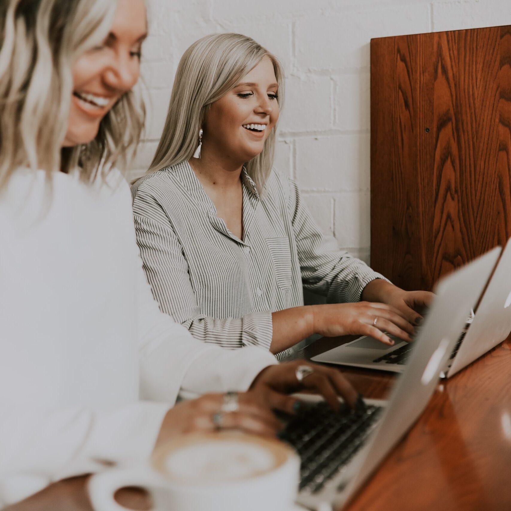 Two women on their laptops