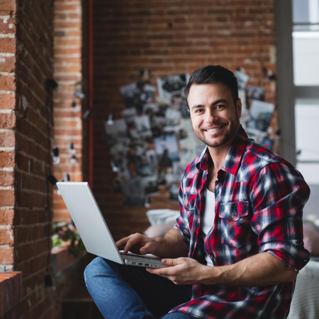 Male bookkeeper using laptop