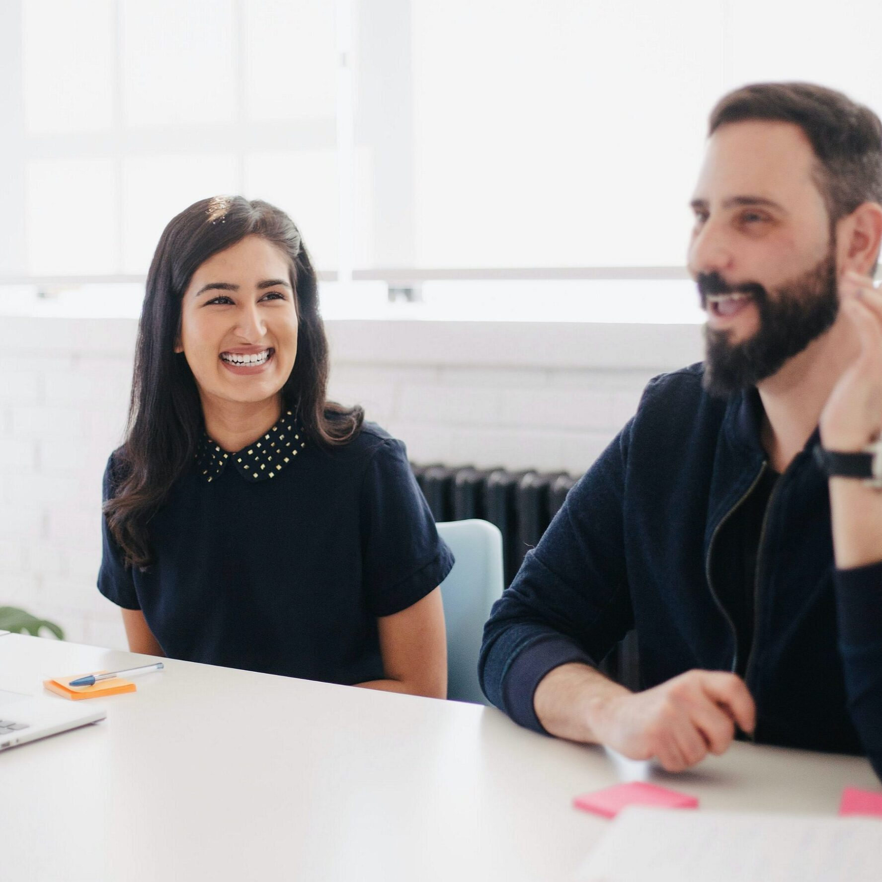 Woman and man smiling at work