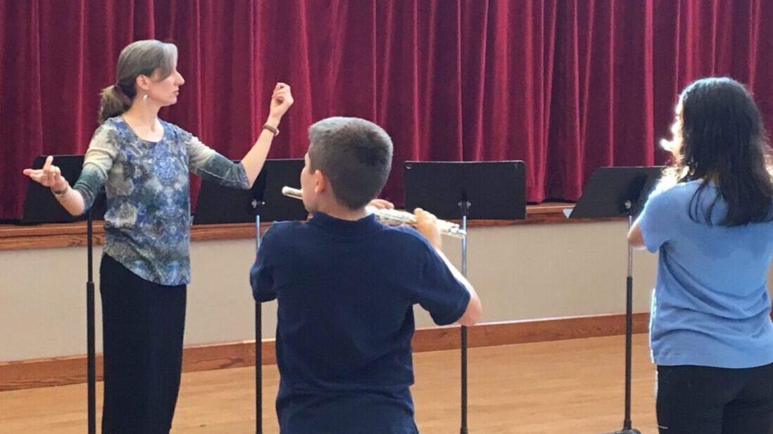 Flute-a-rama-teacher-Melissa-Lindon-conducts-rehearsal.jpg