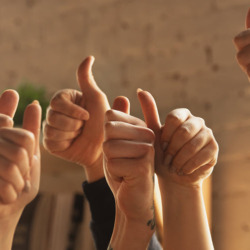 group of employees thumbs up
