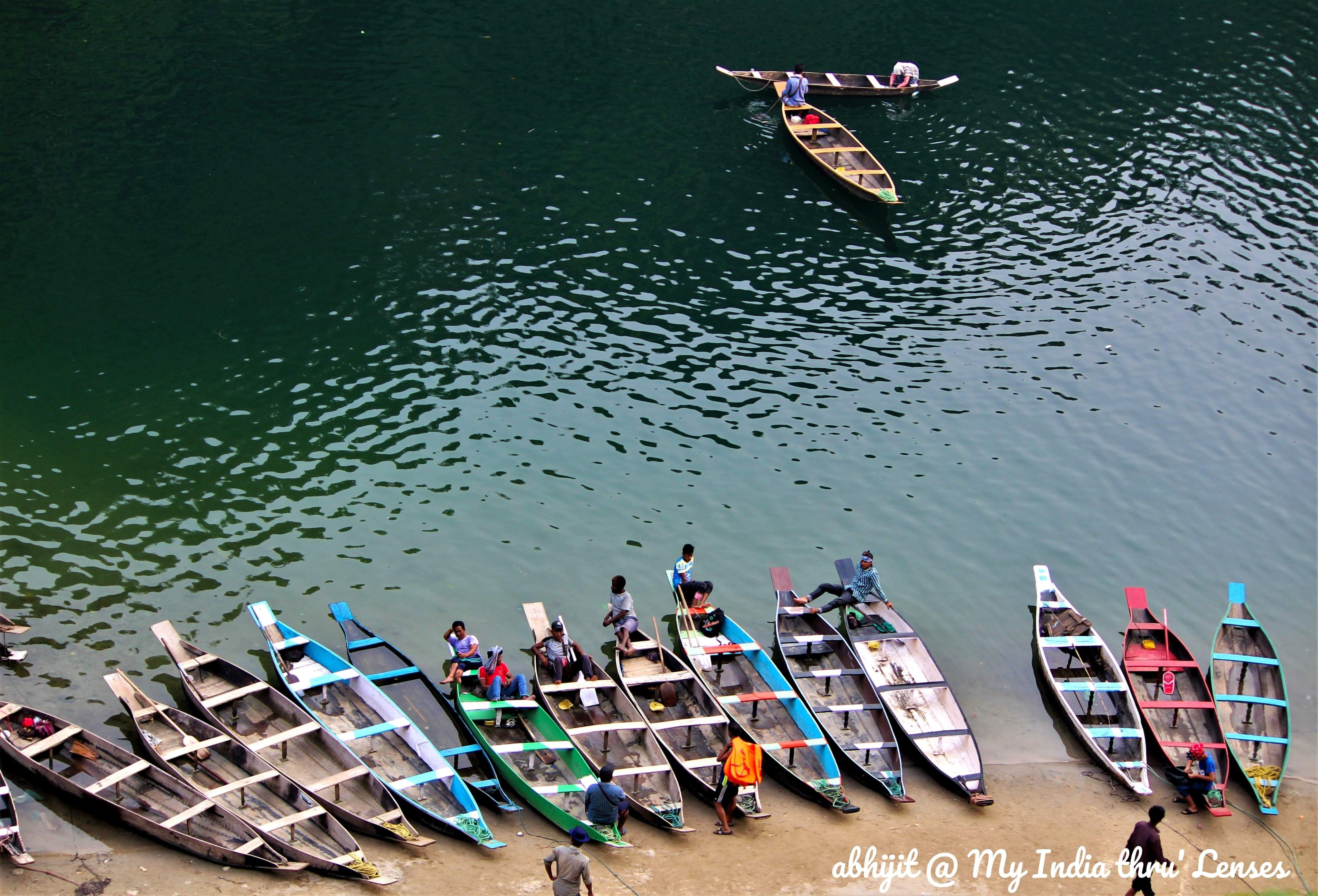 Colourful Boats look awesome on a Greenish background of Umgot water