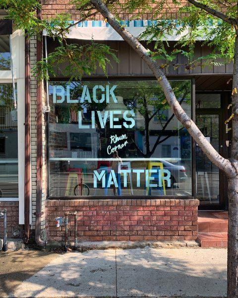 Black Lives Matter written in blue paint in store window