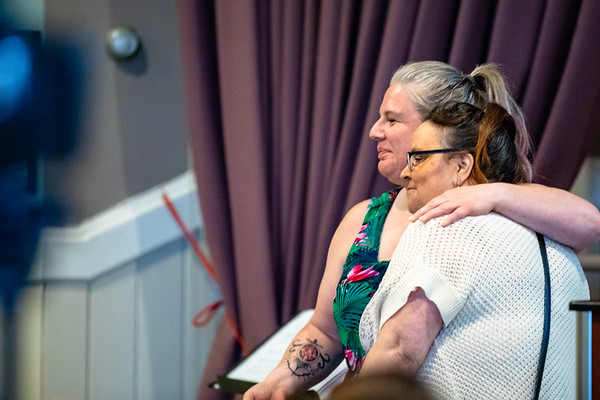 Real Help social worker comforts participant