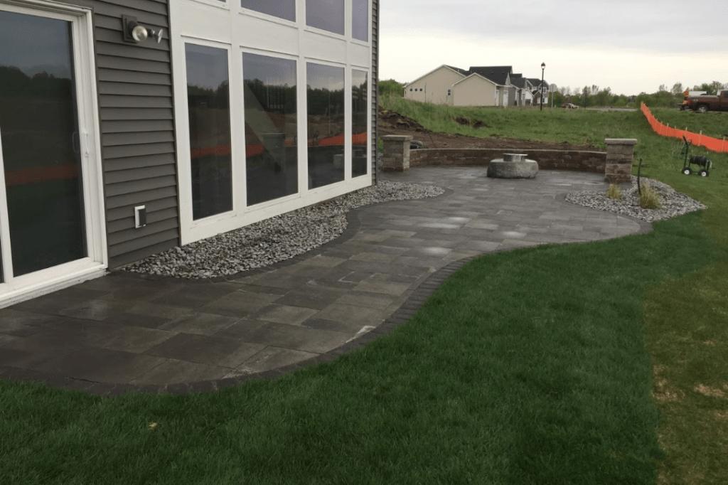 backyard paver patio with custom fire pit