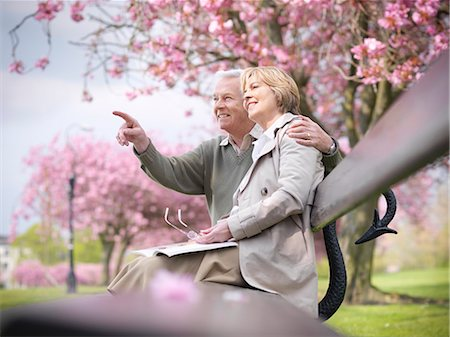 649-03883678 © Masterfile Royalty-Free Model Release: Yes Property Release: No Older couple sitting on park bench