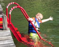 boy on red wetstep ladder