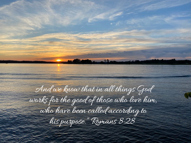 Sunset over lake with verse