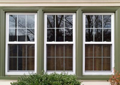 New white with green trim vinyl replacement windows. Horizontal.