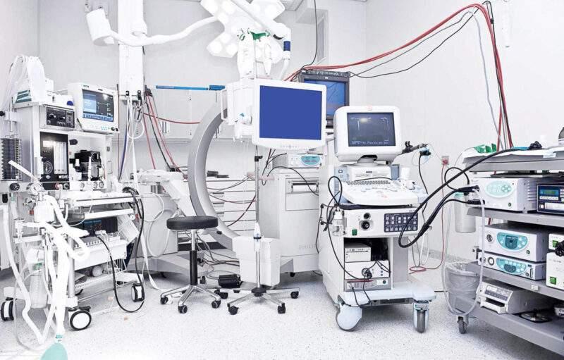 A hospital room full of medical equipment