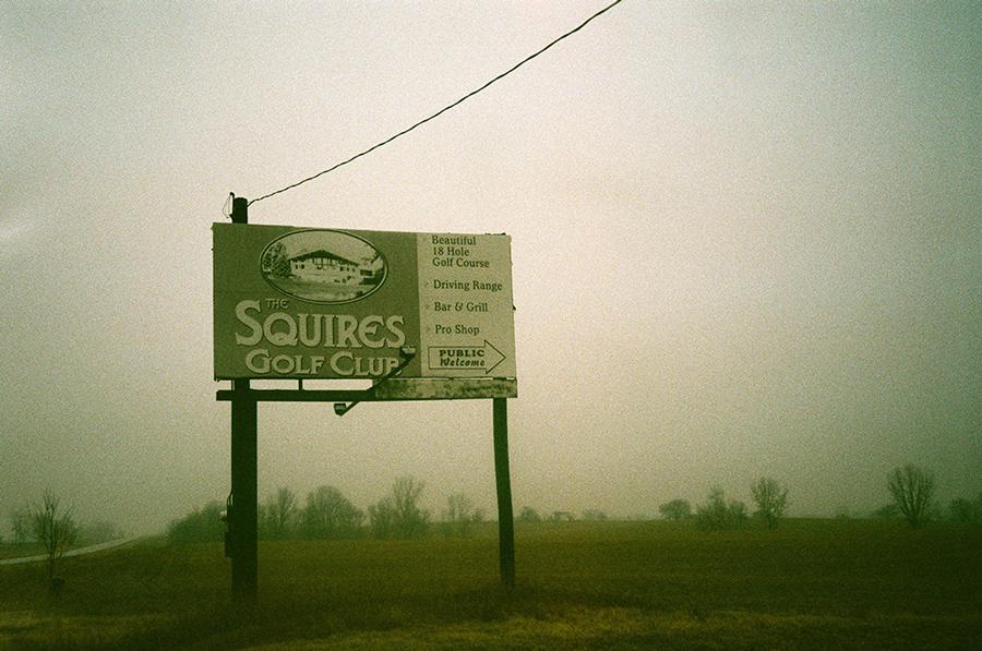 """Billboard reading """"Squires Golf Club"""" in fog"""