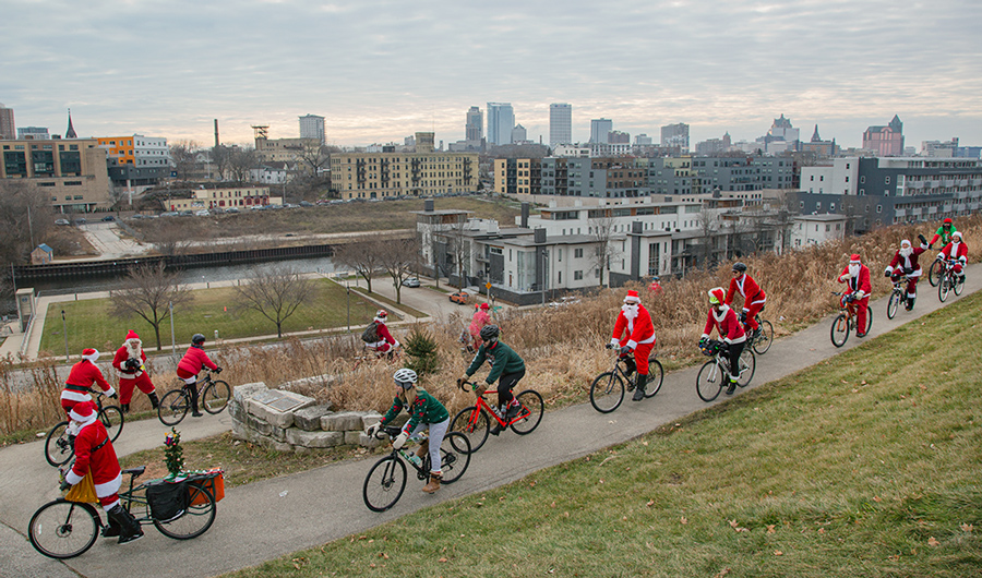 Santa Rampage cyclists in Kadish Park with Milwaukee skyline