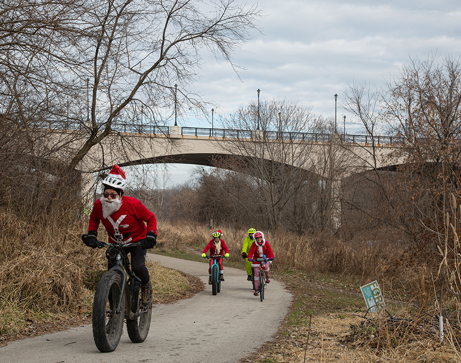 Santa Rampage cyclists on the Beerline Trail in the Milwaukee River Greenway