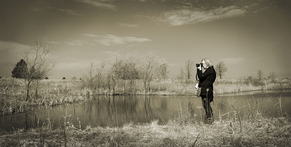 Artist in Residence Vicki Reed photographing at Forest Beach Migratory Preserve