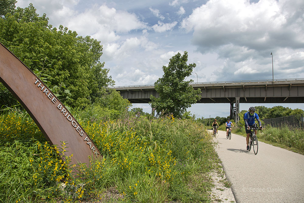 Three cyclists on the Hank Aaron State Trail in Three Bridges Park