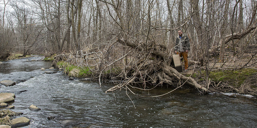 The artist with canvas next to Sauk Creek