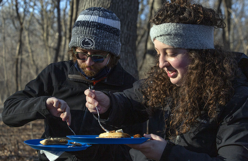 Digging in to campfire-grilled pancakes and home-made (by the UEC) syrup at Riverside Park