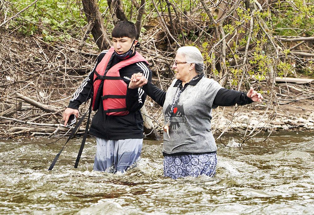 Jaden helps Dawn to the shore