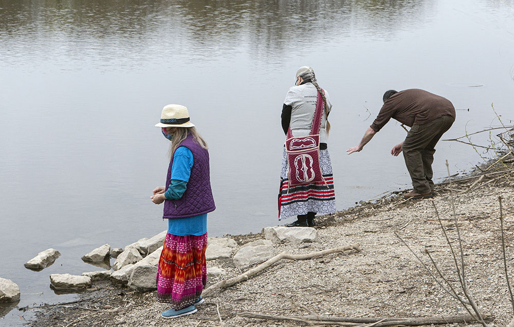Offering tobacco to the river before setting out.