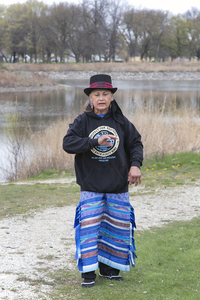 Oralann Caldwell, a Menominee Water Protector, introduces the group to the historical significance of the event.