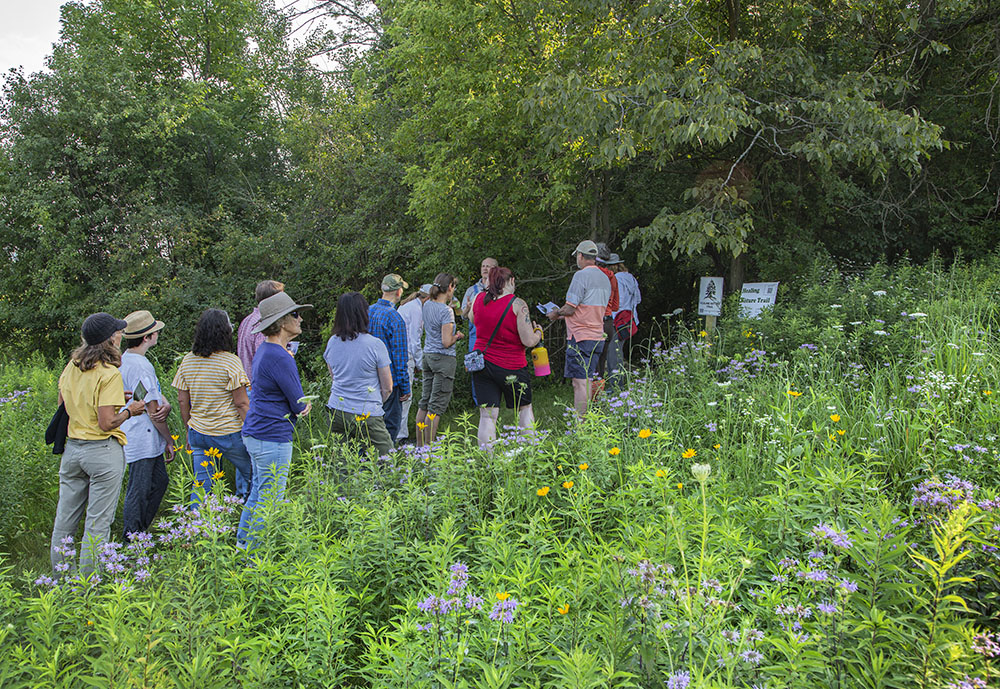A tour group prepares to embark on the Healing Nature Trail.