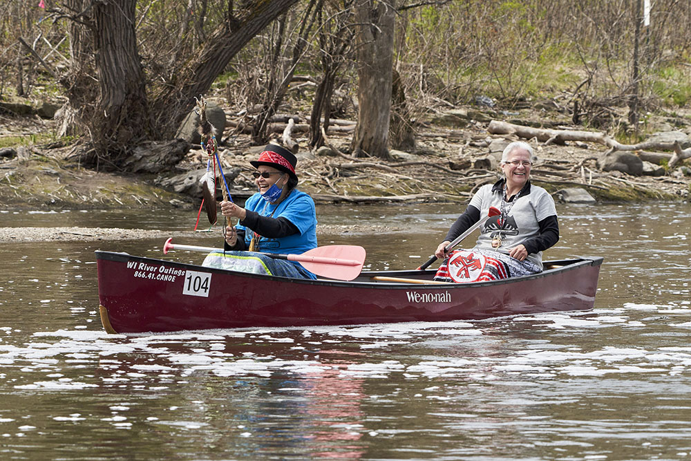 Menominee Water Protectors Jwin Zillier and Dawn Wilbur enjoy their canoe journey on the Milwaukee RIver.