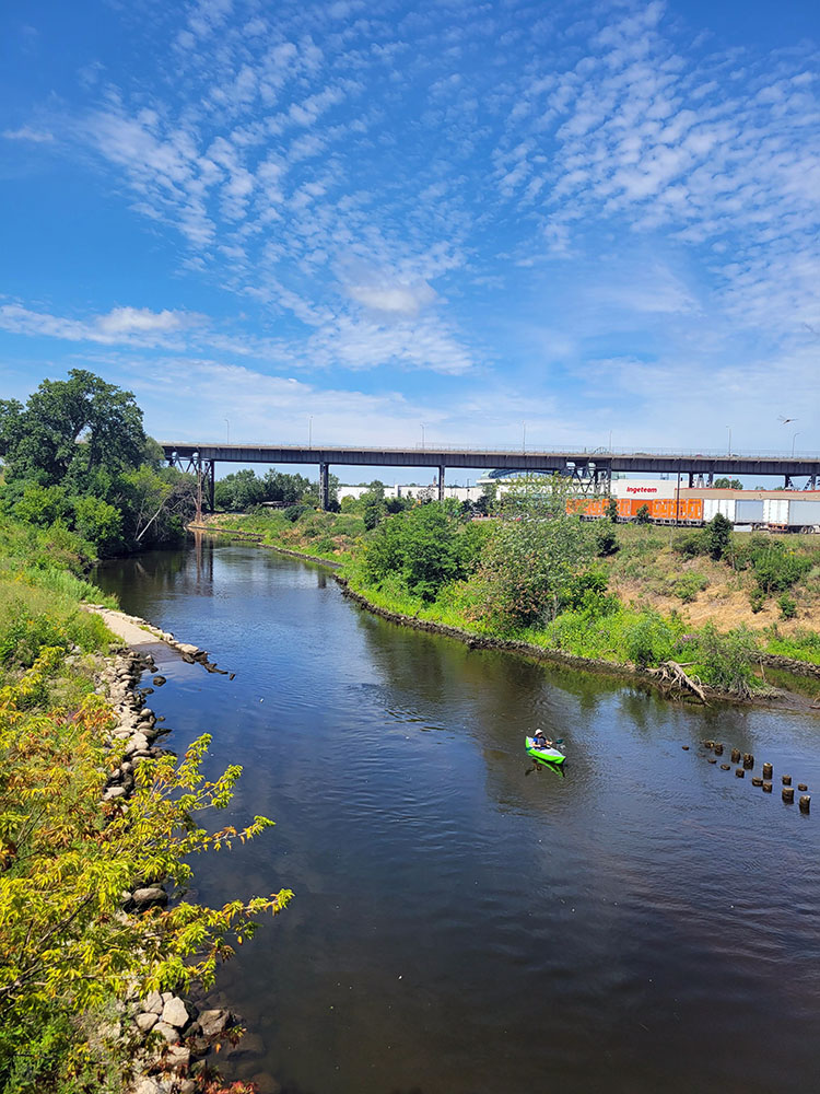 A lone kayaker on the Menomonee River.