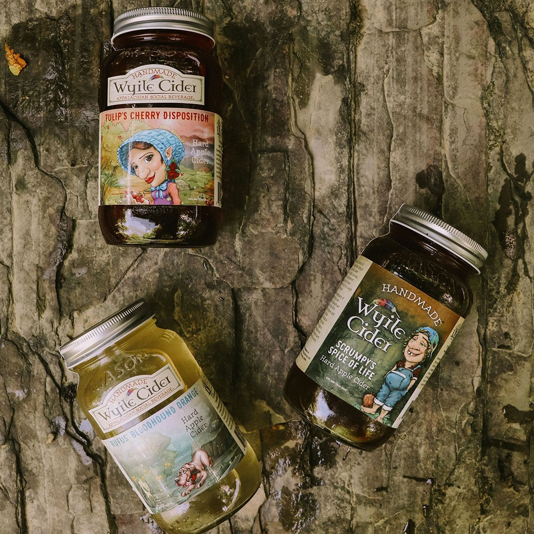 3 mason jars of Wyile Cider on a piece of wood