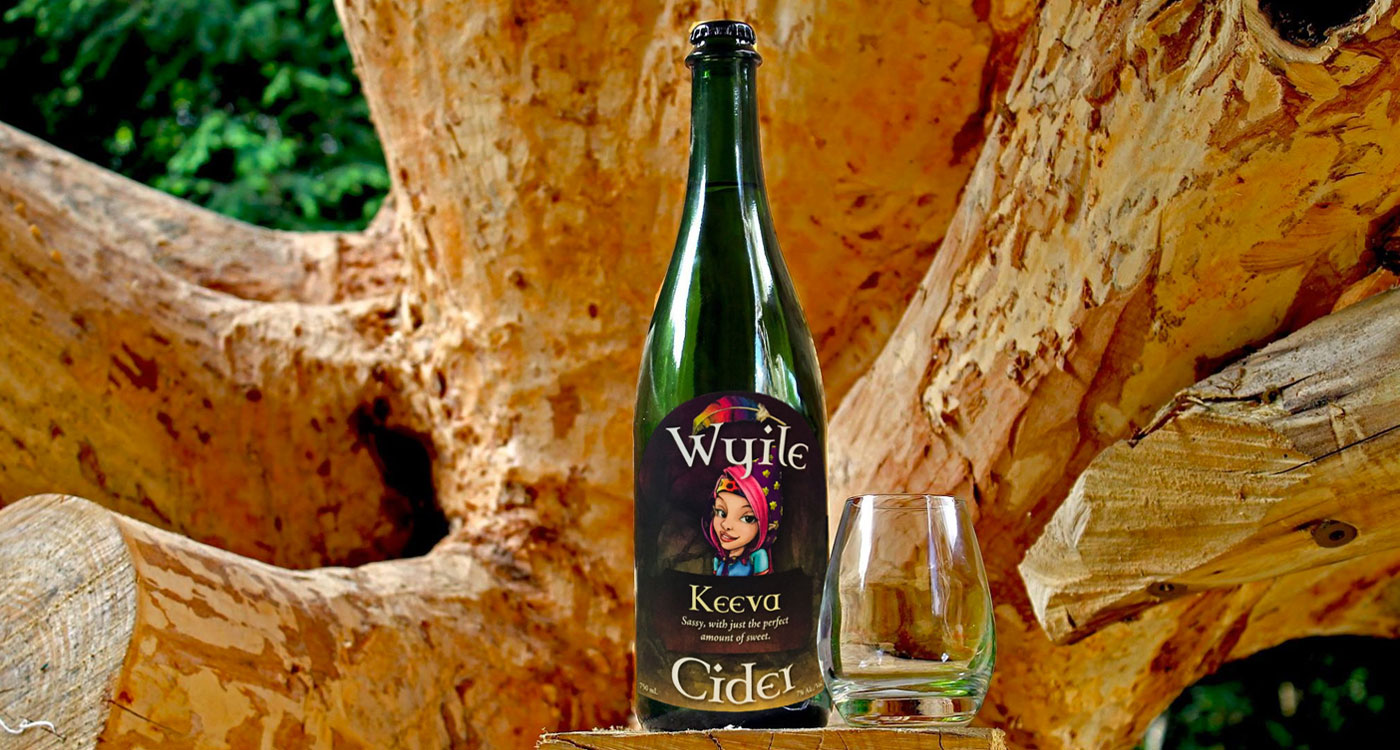 Bottle of Wyile Cider named Keeva in front of tree trunk