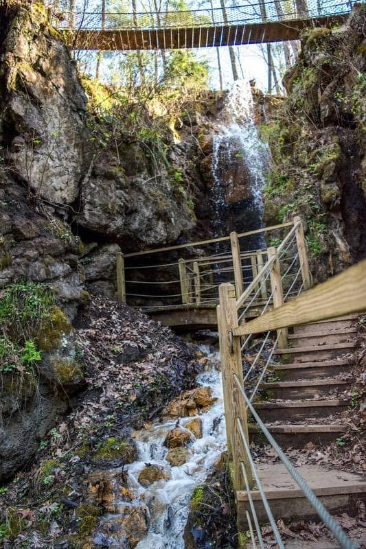Wooden stairs walking up the waterfall at Foxfire Mountain