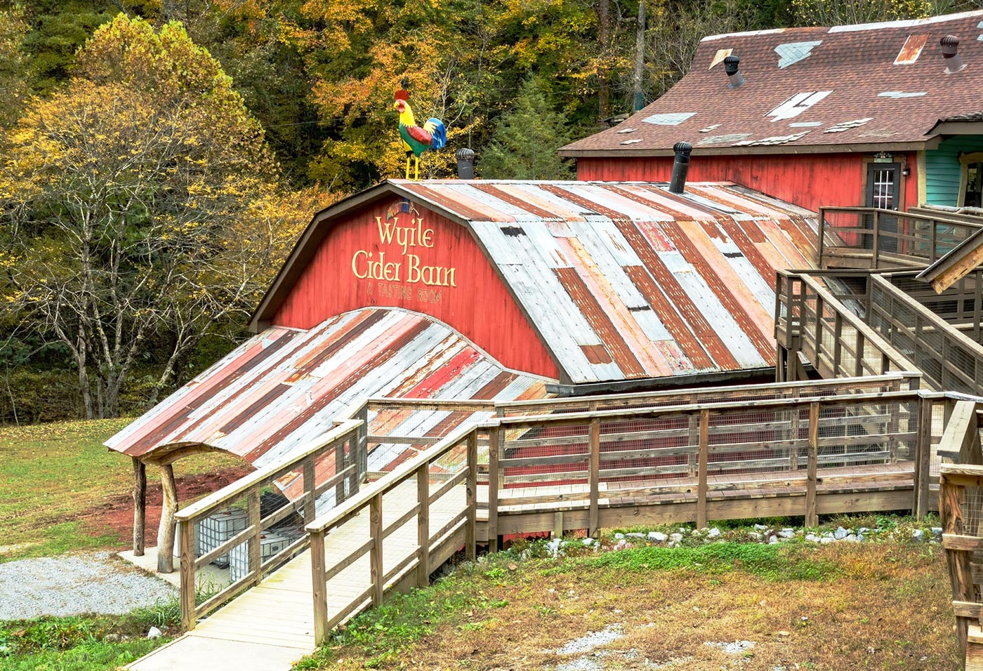 Wyile Cider Barn at Foxfire Mountain - Red Barn with multicolored roof and rainbow rooster