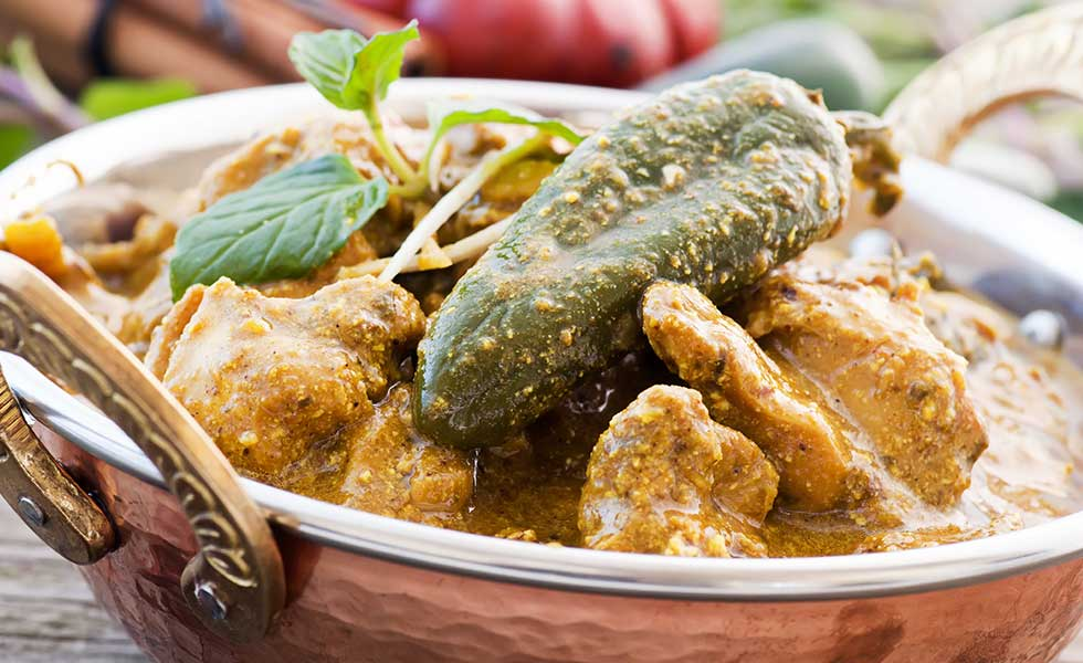 Silver Spoon's curry menu known as Chicken Achar.