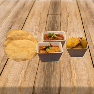 Breakfast menu consisting of halwa puri & curry