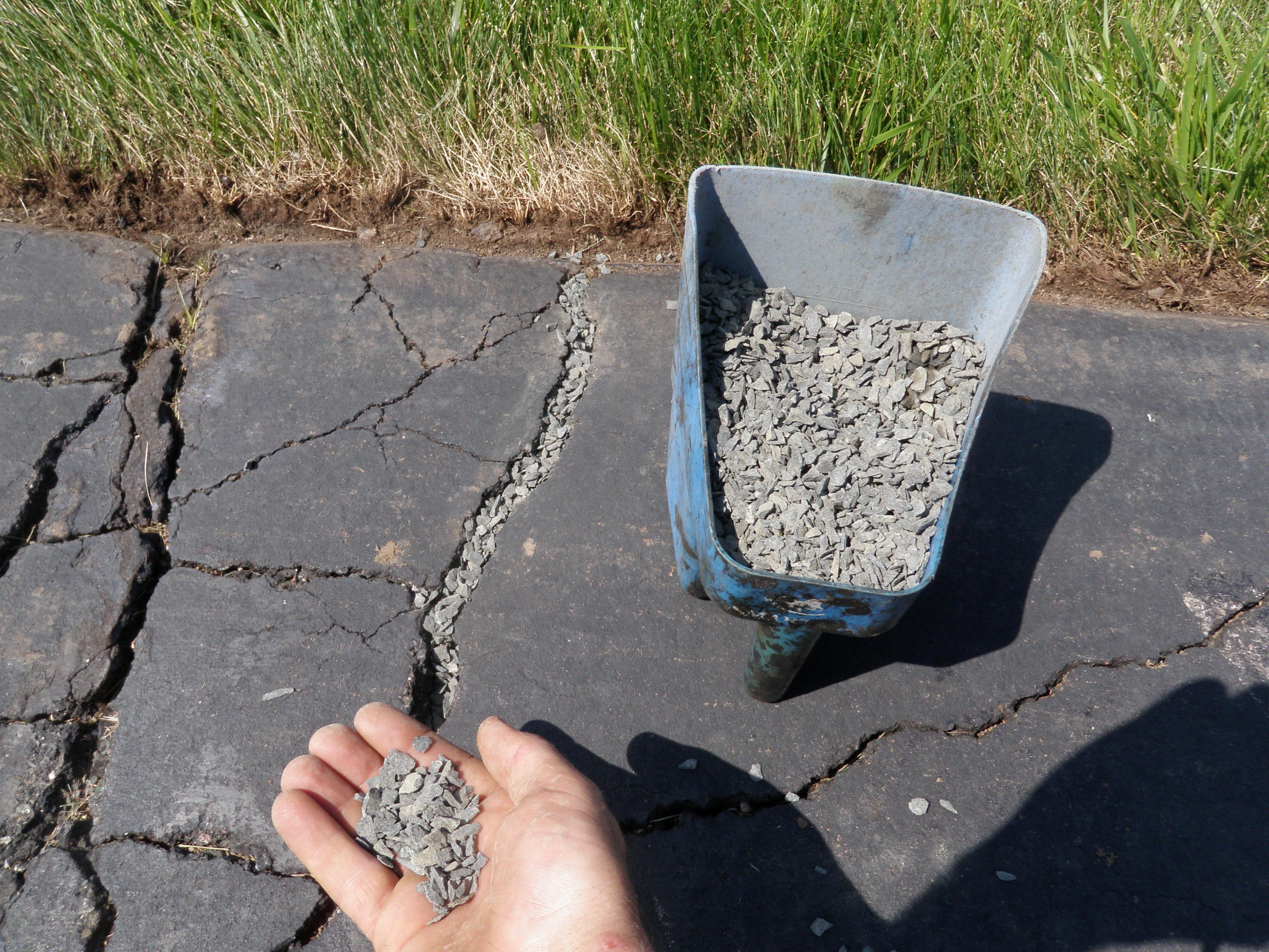 Large Crack Driveway Repair with Gravel 3