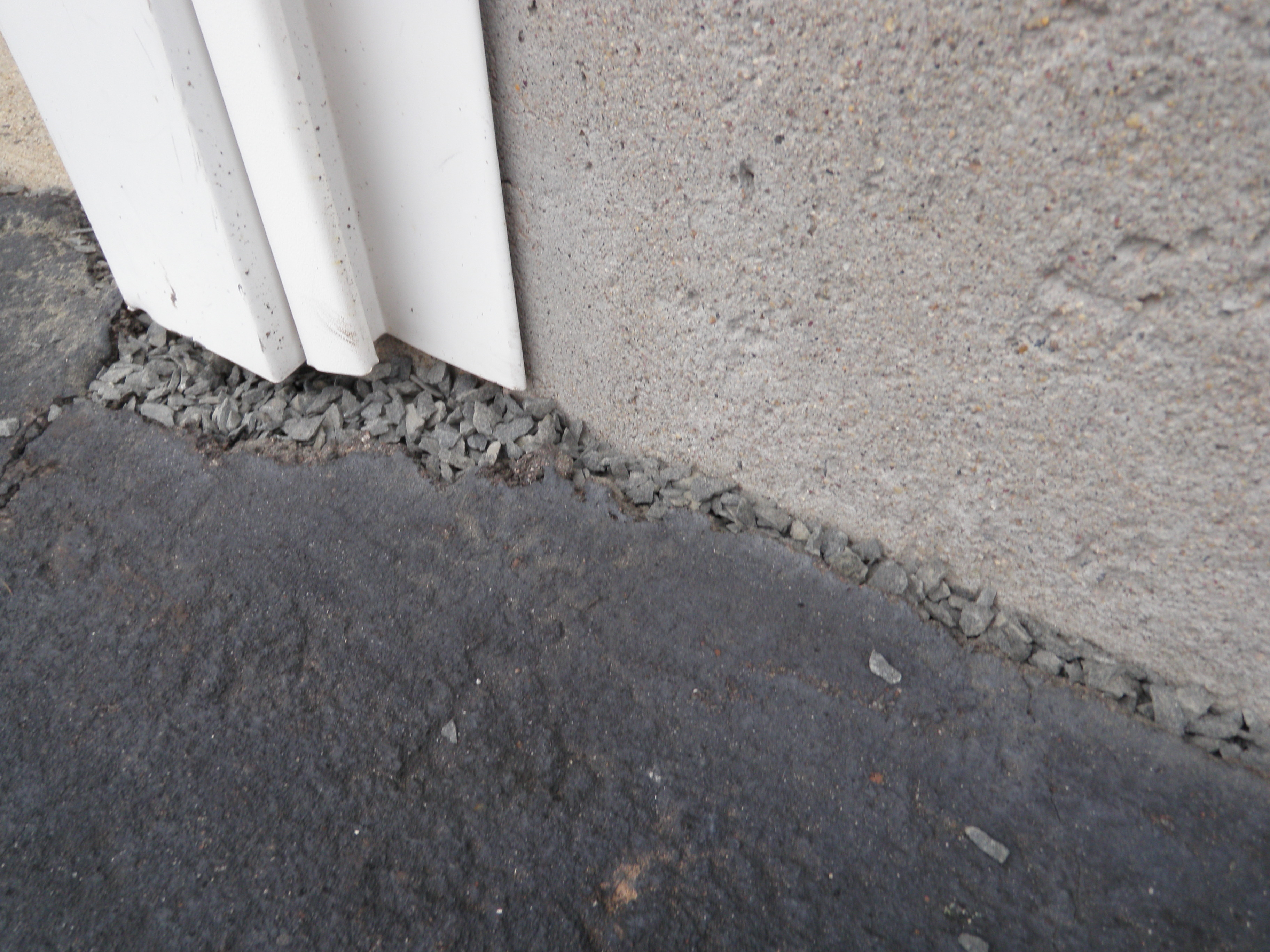 Large Crack Driveway Repair with Gravel