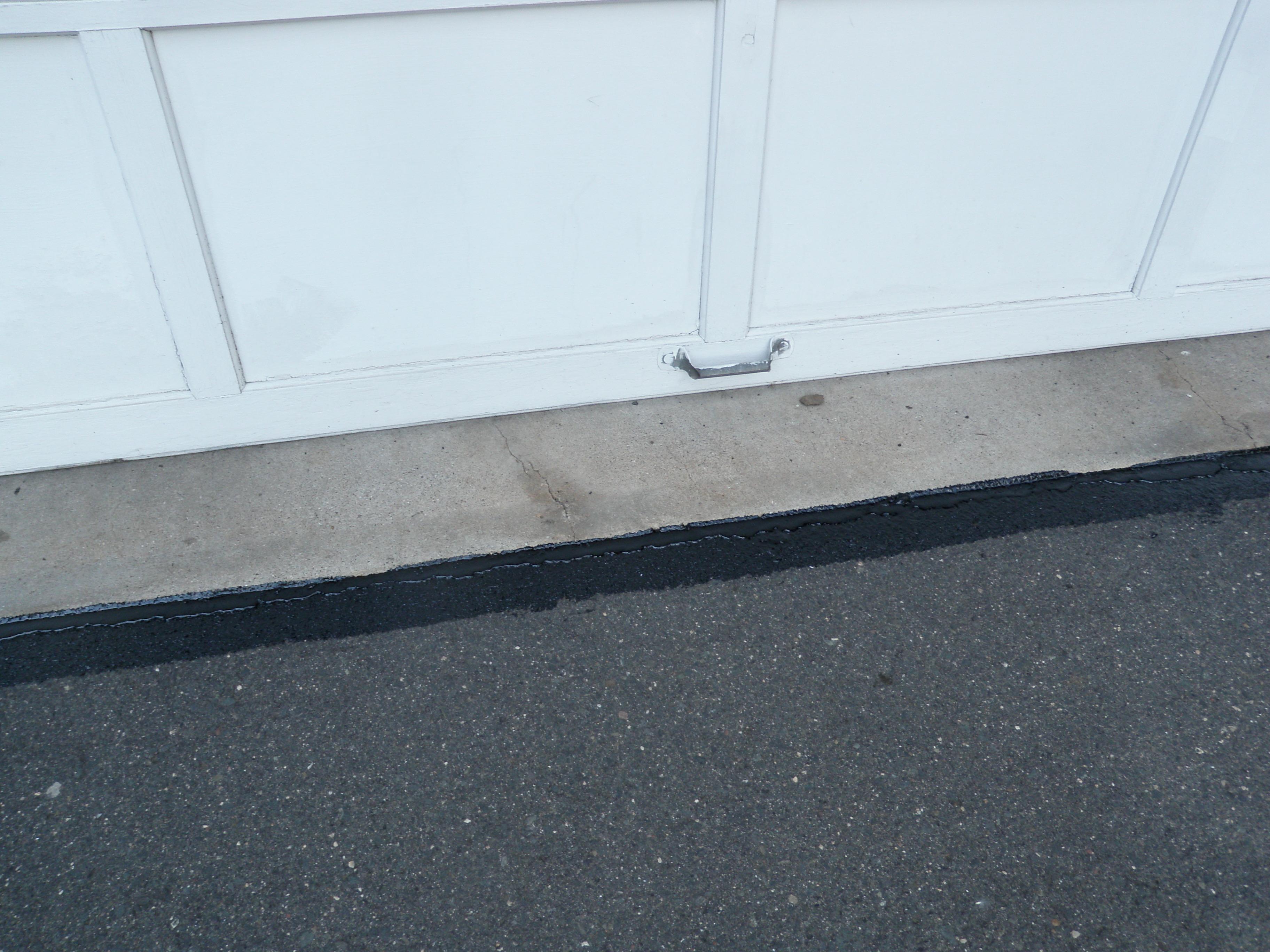Sealant Between Garage and Driveway